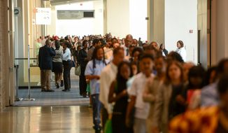 Job seekers wait in very long lines to enter Mayor Gray's 2014 Citywide Hiring Fair at the Walter E. Washington Convention Center, Washington, D.C., Wednesday, July 30, 2014. (Andrew Harnik/The Washington Times) **FILE**