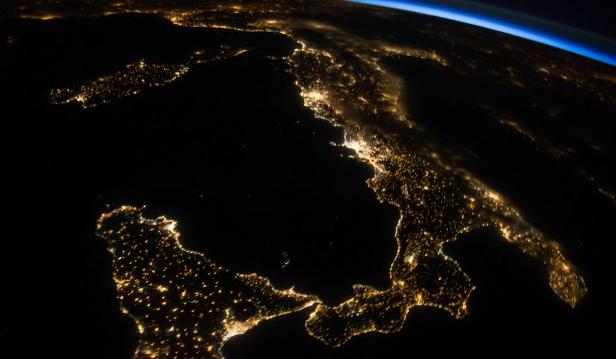 ** FILE ** This oblique night image made by an Expedition 40 crew member and provided by NASA shows Italy and Sicily on July 26, 2014, as seen from the International Space Station. (AP Photo/NASA)