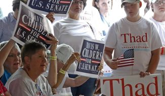 Supporters of the two primary candidates for the U.S. Senate seat, incumbent Republican Sen. Thad Cochran and Democrat Travis Childers listen to speakers at the Neshoba County Fair in Philadelphia, Miss., Thursday, July 31, 2014. The fair is a traditional gathering place for politicians, area residents, business leaders, voters and families. (AP Photo/Rogelio V. Solis) ** FILE **