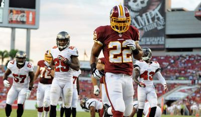 Evan Royster (22) is one of several players in competition on the Redskins' roster who are competing in training camp to be the backup running backs behind  starter Alfred Morris. The Chantilly native is trying to avoid the fate he suffered in 2011, when he was cut and signed to the practice squad. (Associated Press)