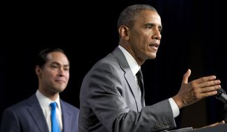 Housing and Urban Development Secretary Julian Castro listens at left as President Barack Obama speaks at the Department of Housing and Urban Development in Washington, Thursday, July 31, 2014. (AP Photo/Jacquelyn Martin)