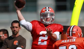 Cleveland Browns quarterback Johnny Manziel (2) throws a pass at the NFL football team's training camp in Berea, Ohio, Thursday, July 31, 2014. (AP Photo/Aaron Josefczyk)