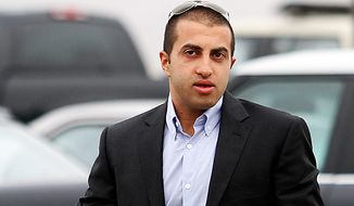 Mosab Hassan Yousef, the oldest son of one of Hamas' founders, said ge was an Israeli spy for a decade, and he abandoned Islam for Christianity, further marking him a traitor.   (AP Photo/Denis Poroy)