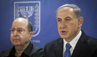 Israeli Defense Minister, Moshe Ya'alon, left, and Israeli Prime Minister Benjamin Netanyahu, center, attend the cabinet meeting at the defense ministry in Tel Aviv, Israel, Thursday, July 31, 2014. (AP Photo/Dan Balilty, pool)