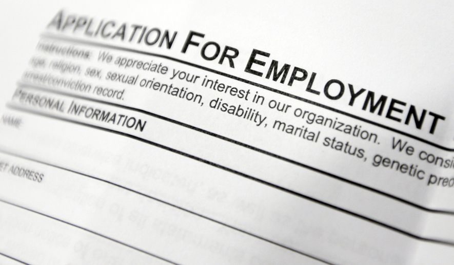 FILE - This April 22, 2014, file photo shows an employment application form on a table during a job fair at Columbia-Greene Community College in Hudson, N.Y.  The Labor Department reports on the number of people who applied for unemployment benefits last week on Thursday, July 31, 2014. (AP Photo/Mike Groll, File)