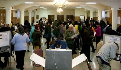 ** FILE ** Voters cast their ballots at St. Francis Church, Precinct 111 polling site in Washington, D.C., to cast their vote, Tuesday, Nov. 6, 2012 (Craig Bisacre/The Washington Times)