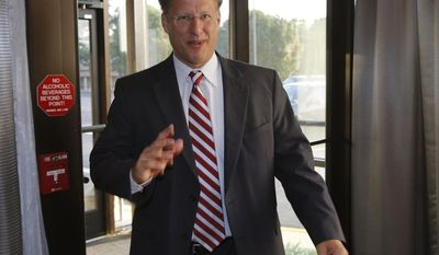 ** FILE ** Republican 7th District congressional candidate Dave Brat gives a statement prior to a Rotary Club breakfast in Richmond, Va., Tuesday, June 17, 2014. Brat defeated House Majority Leader Eric Cantor in last week's Republican primary. (AP Photo/Steve Helber)