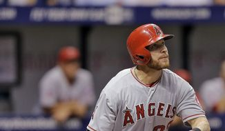 Los Angeles Angels' Josh Hamilton follows the flight of his home run off Tampa Bay Rays starting pitcher Jeremy Hellickson during the third inning of a baseball game Friday, Aug. 1, 2014, in St. Petersburg, Fla. (AP Photo/Chris O'Meara)