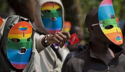 ** FILE ** In this Feb. 10, 2014, file photo, Kenyan gays, lesbians and supporters wear masks to preserve their anonymity, as they stage a rare protest, against Uganda's increasingly tough stance against homosexuality outside the Uganda High Commission in Nairobi, Kenya. (AP Photo/Ben Curtis, File)
