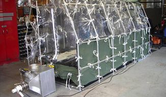"In this undated photo released by the Center for Disease Control, a Aeromedical Biological Containment System which looks like a sealed isolation tent for Ebola air transportation is shown. On Thursday afternoon July 31, 2014, officials at Atlanta's Emory University Hospital said they expected one of the Americans to be transferred there ""within the next several days."" The hospital declined to identify which aid worker, citing privacy laws. (AP Photo/Center for Disease Control)"