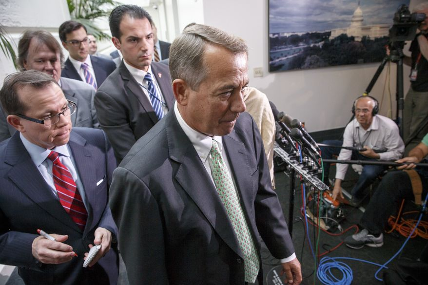 Speaker of the House John Boehner of Ohio, walks past reporters following a closed-door meeting of House Republicans on Capitol Hill in Washington, Friday, Aug. 1, 2014, to discuss the border crisis. House Republicans expressed optimism that a revised, $694 million bill addressing the surge of immigrants at the U.S.-Mexico border would win over reluctant conservatives and give a divided GOP a political win. (AP Photo/J. Scott Applewhite)
