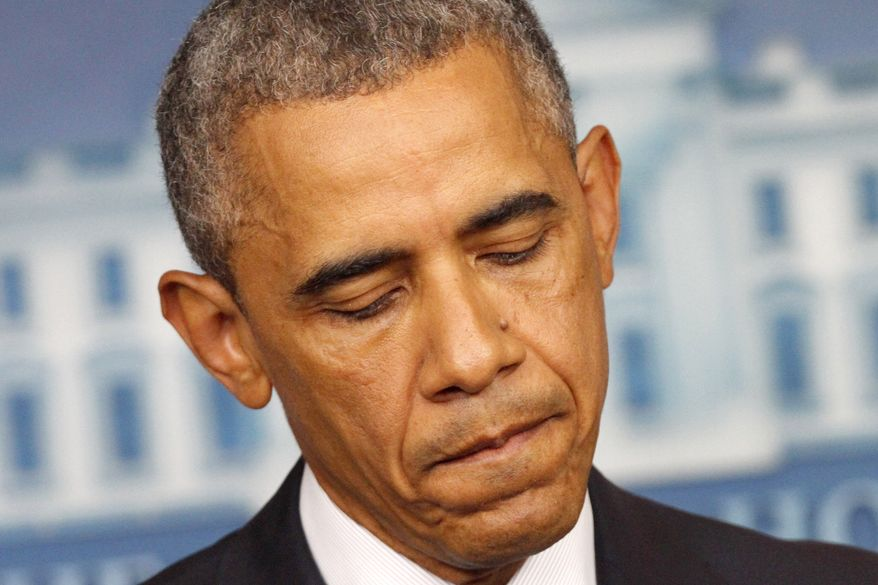 President Barack Obama pauses while answering a question about the escalating situation in the Middle East, Friday, Aug. 1, 2014, in the Brady Press Briefing Room of the White House in Washington. (AP Photo/Jacquelyn Martin)