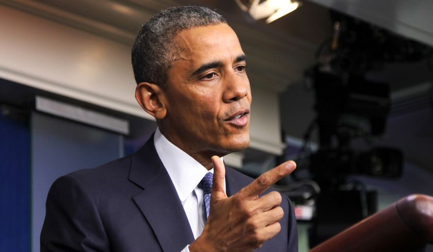 President Barack Obama speaks in the Brady Press Briefing Room of the White House in Washington, Friday, Aug. 1, 2014. The president spoke on various topics including the economy, immigration, Ukraine and the Middle East.  (AP Photo/Connor Radnovich)