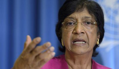 U.N. High Commissioner for Human Rights, South African Navi Pillay, answers journalist's questions about the human rights situation in the world, during a press conference at the Geneva Press Club, in Geneva, Switzerland, Thursday, July 31, 2014. (AP Photo/Keystone, Martial Trezzini)
