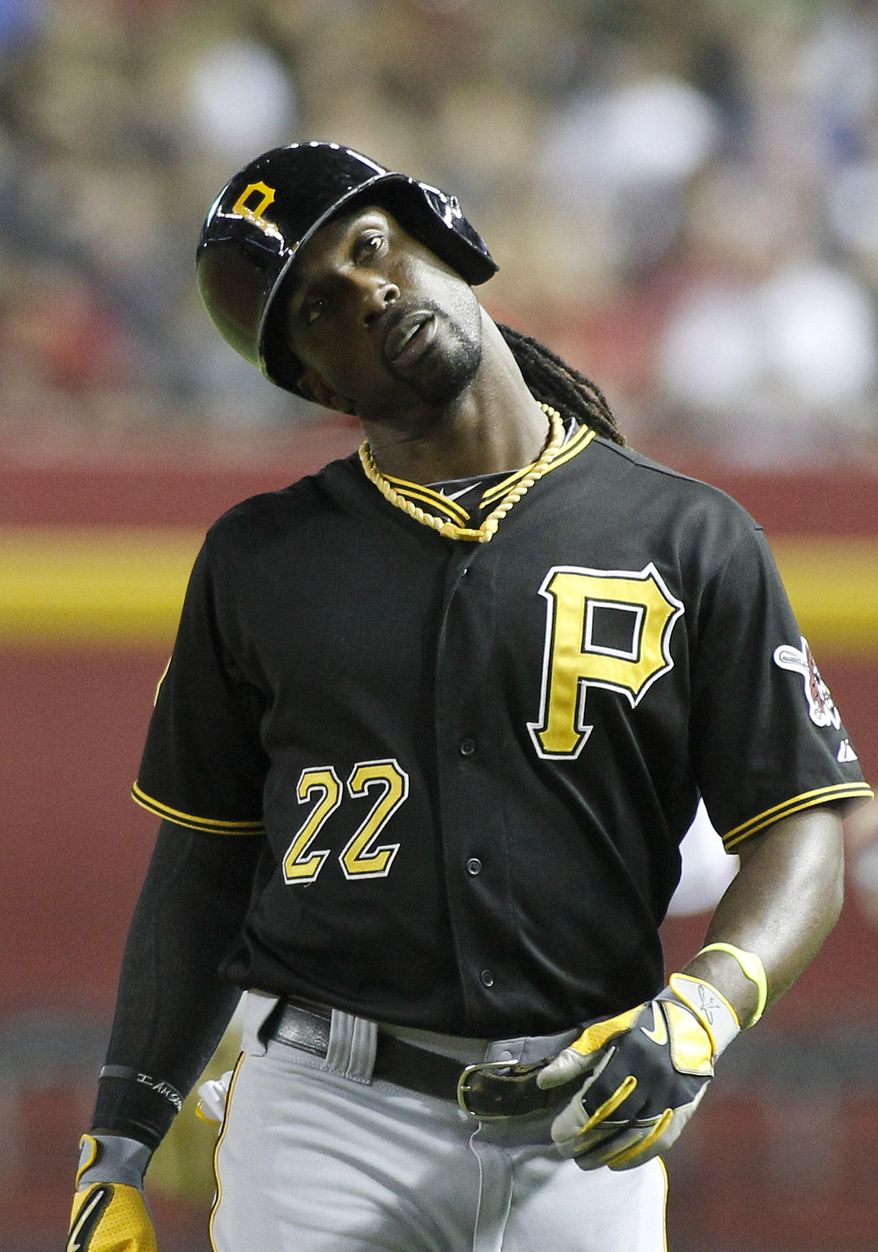 Pittsburgh Pirates' Andrew McCutchen reacts after grounding out against the Arizona Diamondbacks during the fourth inning of a baseball game, Friday, Aug. 1, 2014, in Phoenix. (AP Photo/Ralph Freso)
