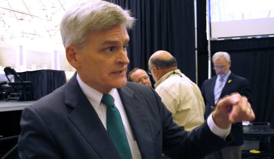 Republican U.S. Rep. Bill Cassidy speaks to the media about his campaign for Louisiana's U.S. Senate seat after talking at the Louisiana Municipal Association's annual convention on Saturday, Aug. 2, 2014, in Baton Rouge, La. Cassidy is running against three-term Democratic incumbent Sen. Mary Landrieu. (AP Photo/Melinda Deslatte)