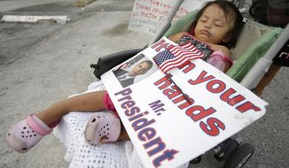 **FILE** Diana Jimenez, 2, sleeps in a stroller during a April 30, 2014, rally sponsored by local immigrant rights organizations, in Homestead, Fla. Jimenez's father was deported to Guatemala two years ago, leaving Jimenez and four siblings in the U.S. (Associated Press)