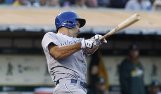 Kansas City Royals' Raul Ibanez hits a home run against the Oakland Athletics during the fifth inning of a baseball game, Friday, Aug. 1, 2014, in Oakland, Calif.  (AP Photo/George Nikitin)
