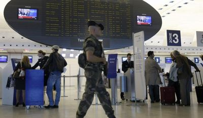 ** FILE ** A French soldier patrols a terminal at Paris' Charles de Gaulle Airport on Monday, Oct. 4, 2010. (AP Photo/Remy de la Mauviniere)