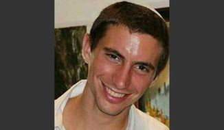 This undated photo shows Israeli Army 2nd. Lt. Hadar Goldin, 23, from Kfar Saba, central Israel. The Israeli military announced early Sunday, Aug. 3, 2014, that Goldin, of the Givati infantry brigade, had been killed in battle on Friday. Goldin was previously believed captured by Hamas gunmen in Gaza violence that shattered a temporary ceasefire. (AP Photo/YNet News)