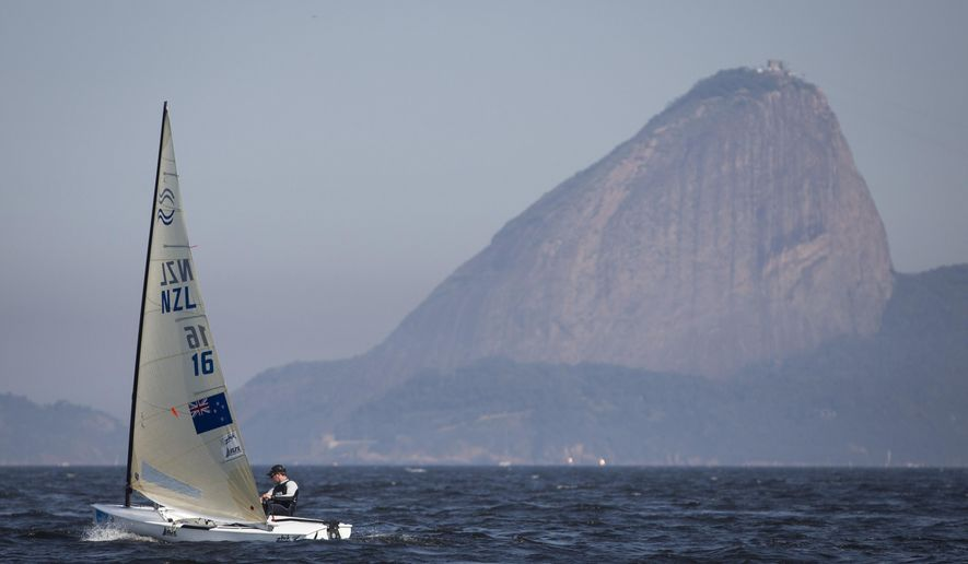 New Zealand's Finn class Andrew Murdoch competes during the first test event for the Rio 2016 Olympic Games at the Guanabara Bay in Rio de Janeiro, Sunday, Aug. 3, 2014. Sugar Loaf Mountain is seen on the background. American sailing officials have hired medical experts to test the water in Guanabara, which has suffered from decades of untreated human waste being poured into the bay. (AP Photo/Felipe Dana)