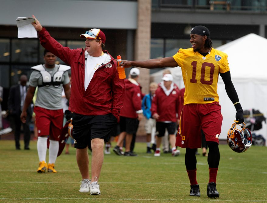 The Redskins, led by coach Jay Gruden and Robert Griffin III, will host the New England Patriots in three days of joint practices starting Monday in Richmond. (Associated Press)