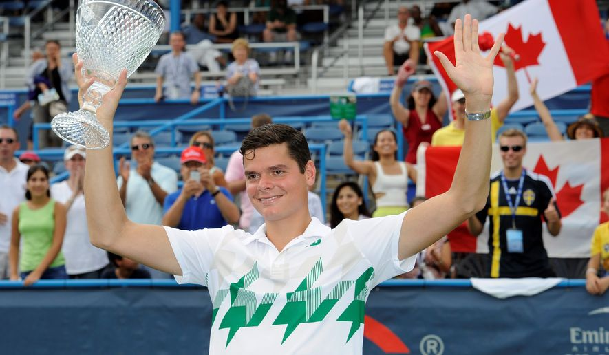 Milos Raonic poses with the trophy after he beat fellow Canadian Vasek Pospisil in the men's singles final at the Citi Open on Sunday in the District. (Associated Press)