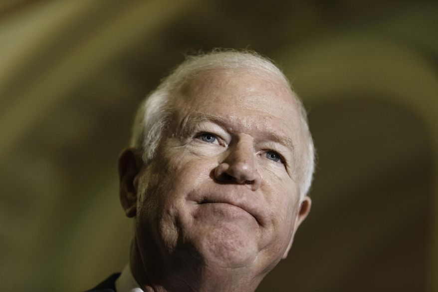 Senate Intelligence Committee Vice Chairman Sen. Saxby Chambliss, Georgia Republican, defended the CIA's use of enhanced interrogation techniques after 9/11.  (AP Photo/J. Scott Applewhite)