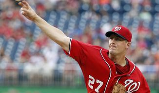 Washington Nationals starting pitcher Jordan Zimmermann throws during the first inning of a baseball game against the Philadelphia Phillies at Nationals Park, Saturday, Aug. 2, 2014, in Washington. (AP Photo/Alex Brandon)