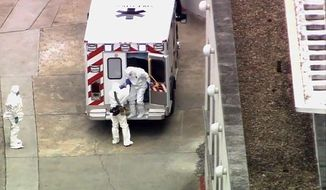 An ambulance arrives with Ebola victim Dr. Kent Brantly to Emory University Hospital in Atlanta. Mr. Brantly, infected with the Ebola virus in Africa, arrived in Atlanta for treatment Saturday. (AP Photo/WSB-TV Atlanta)