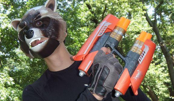 Hasbro's Raccoon Action Mask and Nerf Quad Blaster. (Photo by Joseph Szadkowski / The Washington Times)