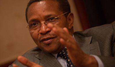 Tanzania President Jakaya Kikwete talks with The Washington Times at the Ritz Carlton Hotel in Northwest.  (Khalid Naji-Allah/Special to The Washington Times)