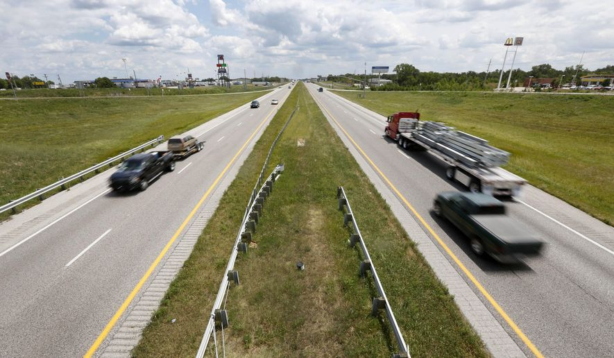 In this photo made Wednesday, July 30, 2014, vehicles move along a section of Interstate 70 in Foristell, Mo. Missouri voters will decide on Aug. 5 whether to allow the state's first general sales tax for transportation projects, such as the proposed widening of I-70 to three lanes from St. Louis to Kansas City. (AP Photo/Jeff Roberson)