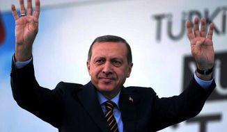 Turkish Prime Minister and presidential candidate of the ruling party in the August election, Recep Tayyip Erdogan waves to his supporters in Istanbul, Turkey, Friday July 25, 2014. (AP Photo/Emrah Gurel)