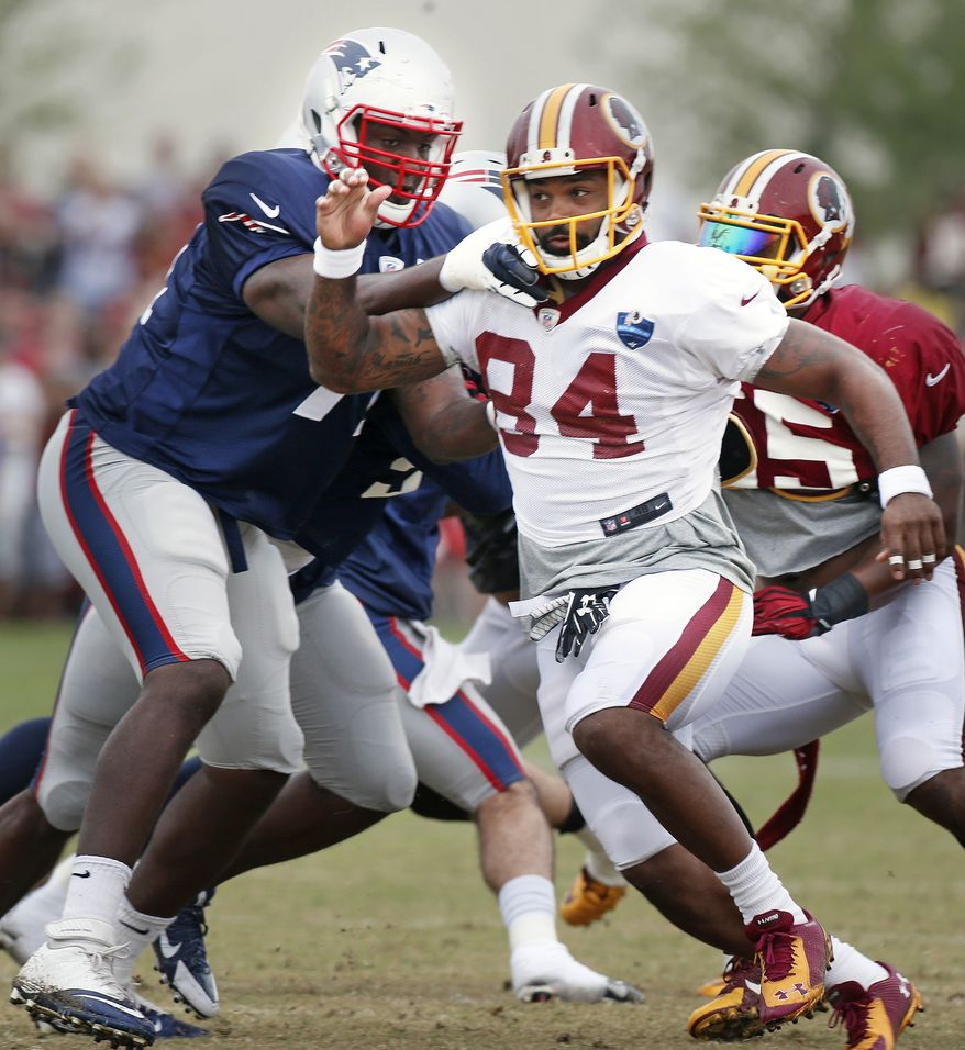 Washington Redskins Niles Paul and New England Patriots Zach Moore work out during practice at the Redskins Training Camp in Richmond, Va., Monday, Aug. 4, 2014.  (AP Photo/Richmond Times-Dispatch, Alexa Welch Edlund)