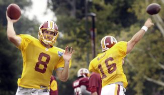 Washington Redskins NFL football quarterbacks Kirk Cousins (8)  and Colt McCoy (16) throw passes during practice Monday, Aug. 4, 2014,  in Richmond, Va. (AP Photo/Jay Paul)