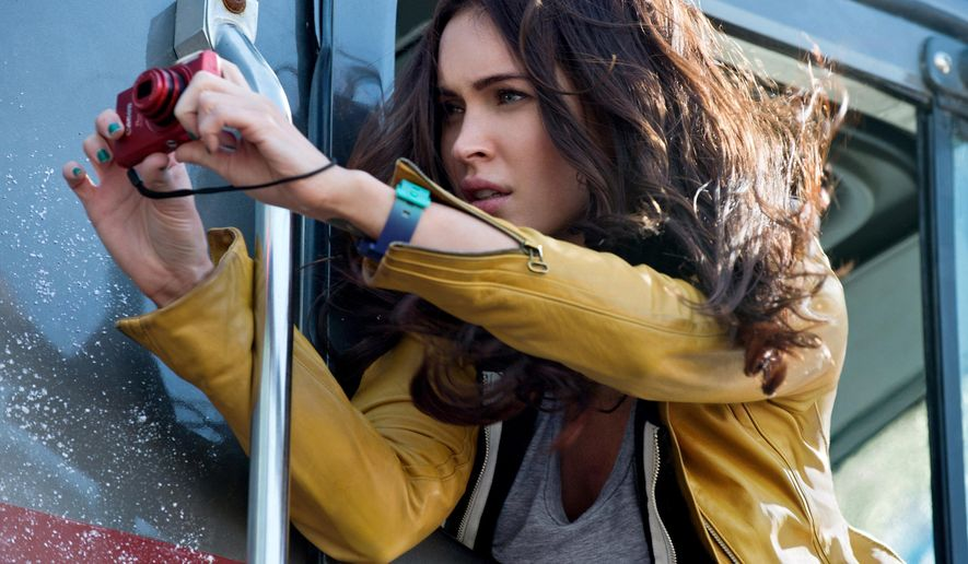 """This image released by Paramount Pictures shows Megan Fox in a scene from """"Teenage Mutant Ninja Turtles."""" (AP Photo/Paramount Pictures, Industrial Light & Magic)"""