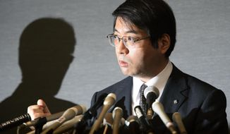 ** FILE ** In this April 16, 2014, photo, Yoshiki Sasai, deputy chief of the RIKEN Center for Developmental Biology, speaks during a press conference in Tokyo. Police said Sasai, 52, was found Tuesday, Aug. 5, 2014, at a government science institute RIKEN in Kobe, western Japan. Sasai had supervised and co-authored stem-cell research papers that had to be retracted due to falsified contents. (AP Photo/Kyodo News)