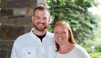 ** FILE ** Dr. Kent Brantly and his wife, Amber, are seen in an undated photo provided by Samaritan's Purse. Brantly became the first person infected with Ebola to be brought to the United States from Africa, arriving at at Emory University Hospital, in Atlanta on Saturday, Aug. 2, 2014. (AP Photo/Samaritan's Purse)