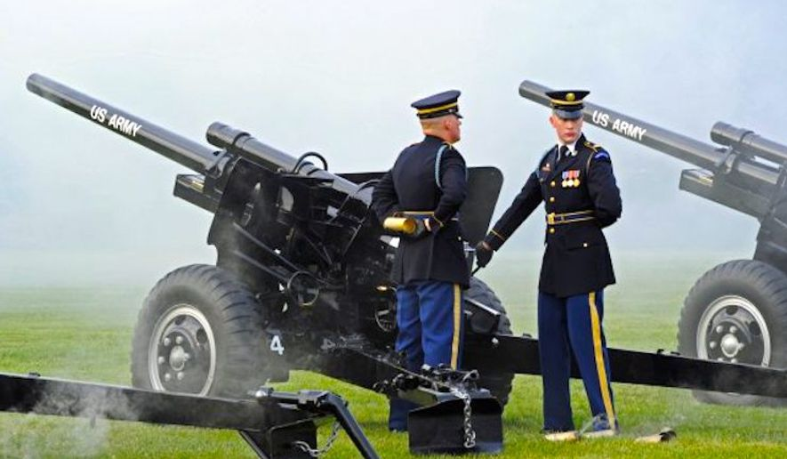"Cue anti-tank guns: The 5,775-pound big bruisers roll out to accentuate the ""1812 Overture,"" the finale for the U.S. Army Band's summer concert series. (U.S. Army)"