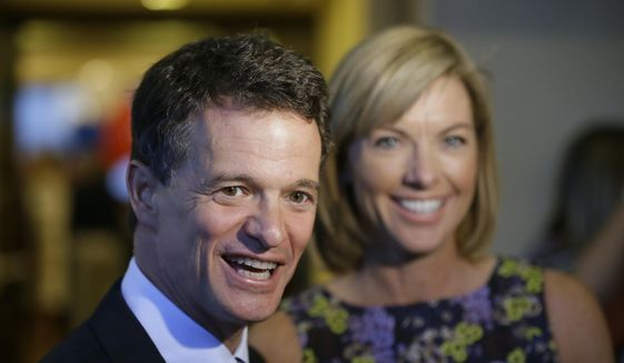 Republican David Trott, then-candidate for Michigan's 11th Congressional District, stands next to his wife, Kappy, during an interview at his election night party, Tuesday, Aug. 5, 2014, in Troy, Mich. (AP Photo/Carlos Osorio) ** FILE **