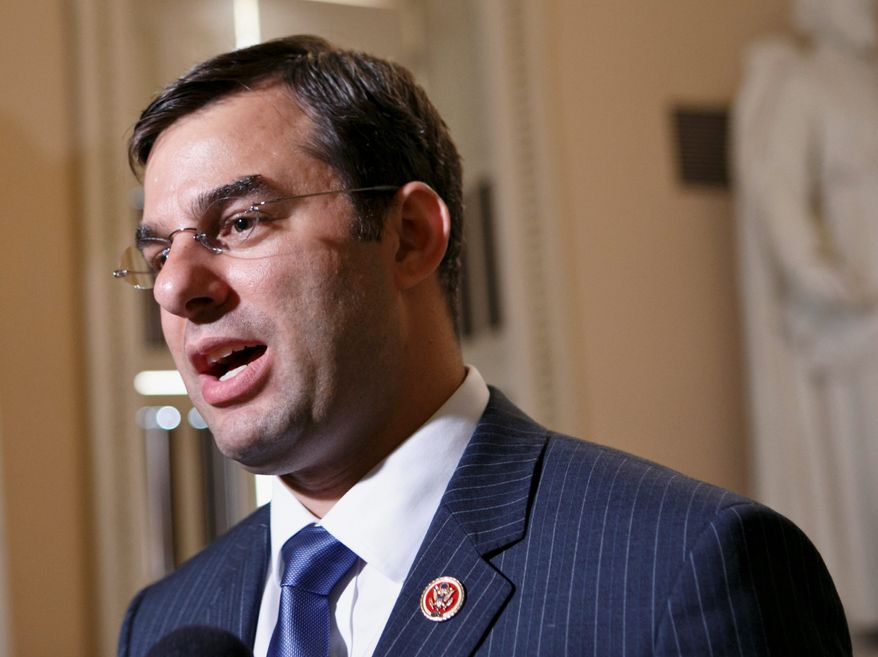 In this July 24, 2013 file photo, Rep. Justin Amash speaks on Capitol Hill in Washington. (AP Photo/J. Scott Applewhite, File) **FILE**