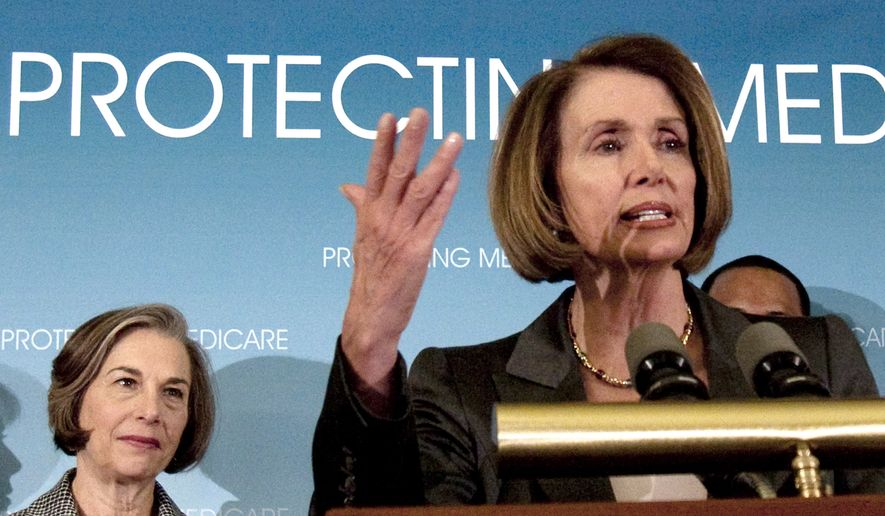 **FILE** House Speaker Nancy Pelosi, California Democrat, accompanied by Rep. Jan Schakowsky, Illinois Democrat, speaks March 16, 2010, during a news conference on Capitol Hill in Washington. (Associated Press)
