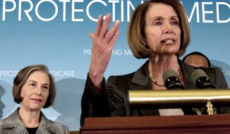 House Speaker Nancy Pelosi, California Democrat, accompanied by Rep. Jan Schakowsky, Illinois Democrat, speaks March 16, 2010, during a news conference on Capitol Hill in Washington. (Associated Press)
