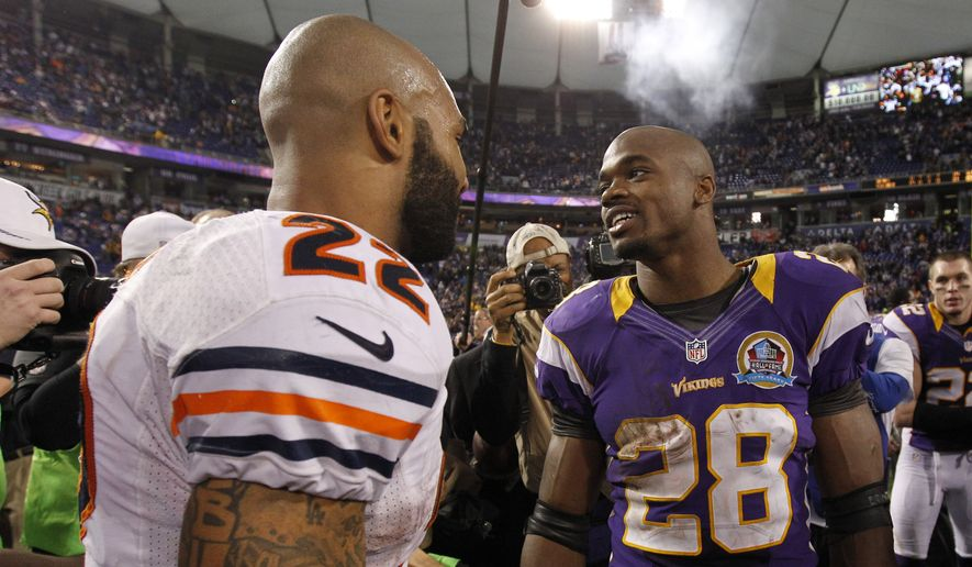 Minnesota Vikings running back Adrian Peterson, right, talks with Chicago Bears running back Matt Forte, left, after an NFL football game Sunday, Dec. 9, 2012, in Minneapolis. The Vikings won 21-14. (AP Photo/Genevieve Ross)