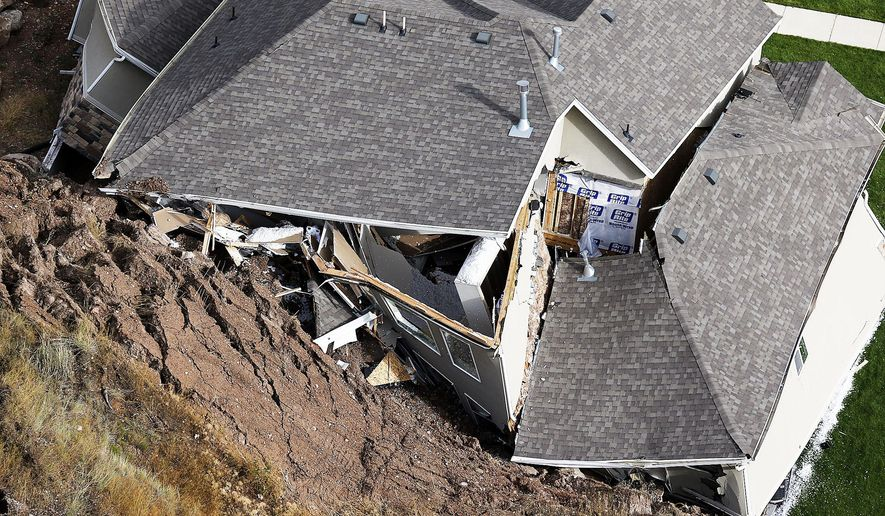 A home is destroyed following a landslide in a hillside community of North Salt Lake, Utah, Tuesday, Aug. 5, 2014. At least a dozen other homes have been evacuated.  (AP Photo/The Deseret News, Ravell Call)  SALT LAKE TRIBUNE OUT;  MAGS OUT