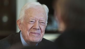 Former President Jimmy Carter has co-written an op-ed criticizing Israel's actions in Gaza. (AP Photo/Charles Dharapak) .  (AP Photo/Bebeto Matthews, File)