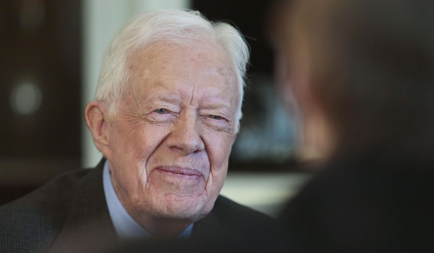 Former President Jimmy Carter has co-written an op-ed criticizing Israel's actions in Gaza. (AP Photo/Charles Dharapak) .  (AP Photo/Bebeto Matthews, File)