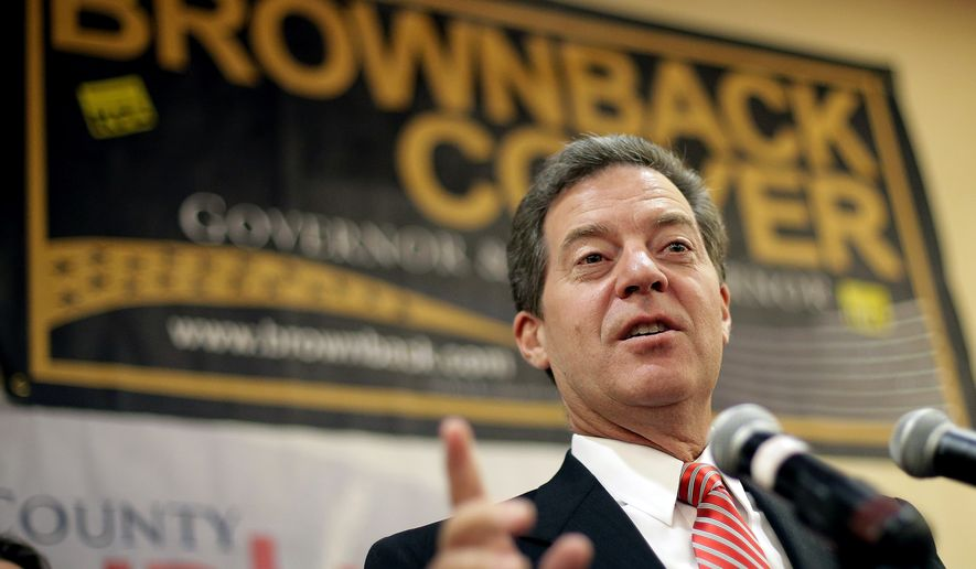 Kansas Gov. Sam Brownback speaks to the crowd at a Johnson County Republican's election watch party Tuesday, Aug. 5, 2014, in Overland Park, Kan. (AP Photo/Charlie Riedel)