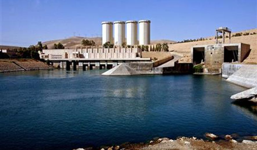 ** FILE **  The advance of the Islamic State of Iraq and the Levant has put Iraq's Mosul Dam, 360 kilometers (225 miles) northwest of Baghdad at risk. (AP Photo/ Khalid Mohammed, File)